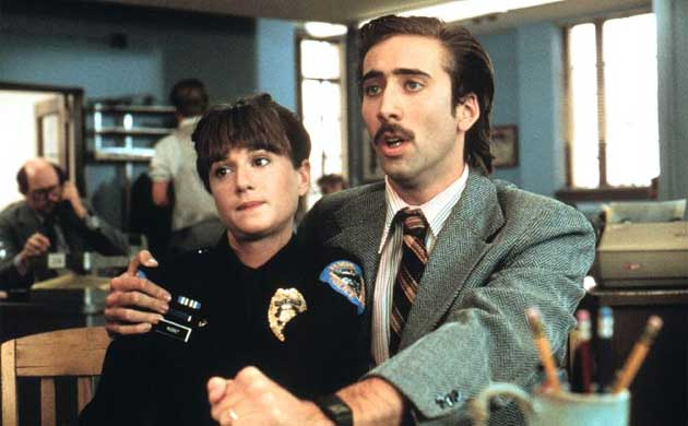 Holly Hunter and Nicholas Cage in Raising Arizona (1987)