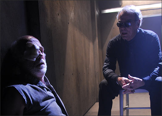 Michael Hogan and Dean Stockwell in an episode from the third season of Battlestar Gallactica (2006)