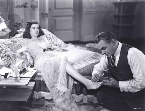 Christopher (Edward G. Robinson) will do anything for Kitty (Joan Bennett) in Scarlet Street (1946)