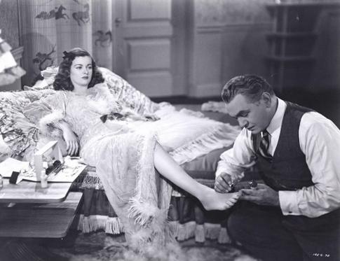 Christopher (Edward G. Robinson) will do anything for Kitty (Joan Bennett) in Scarlet Street (1946)